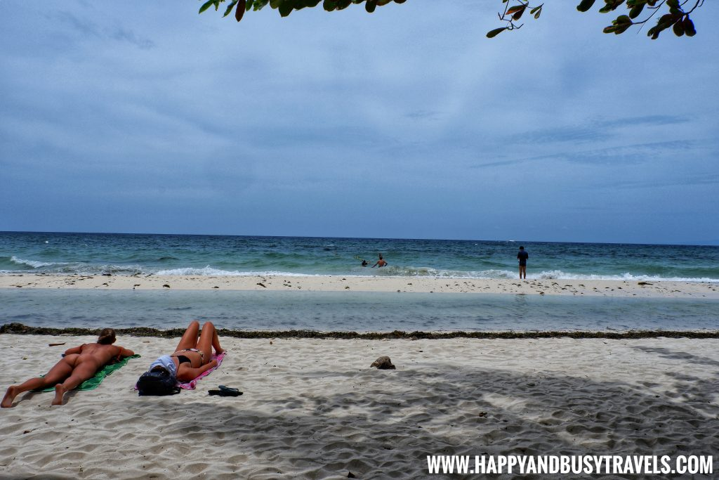 Alona Tropical Beach Resort foreigners sunbathing