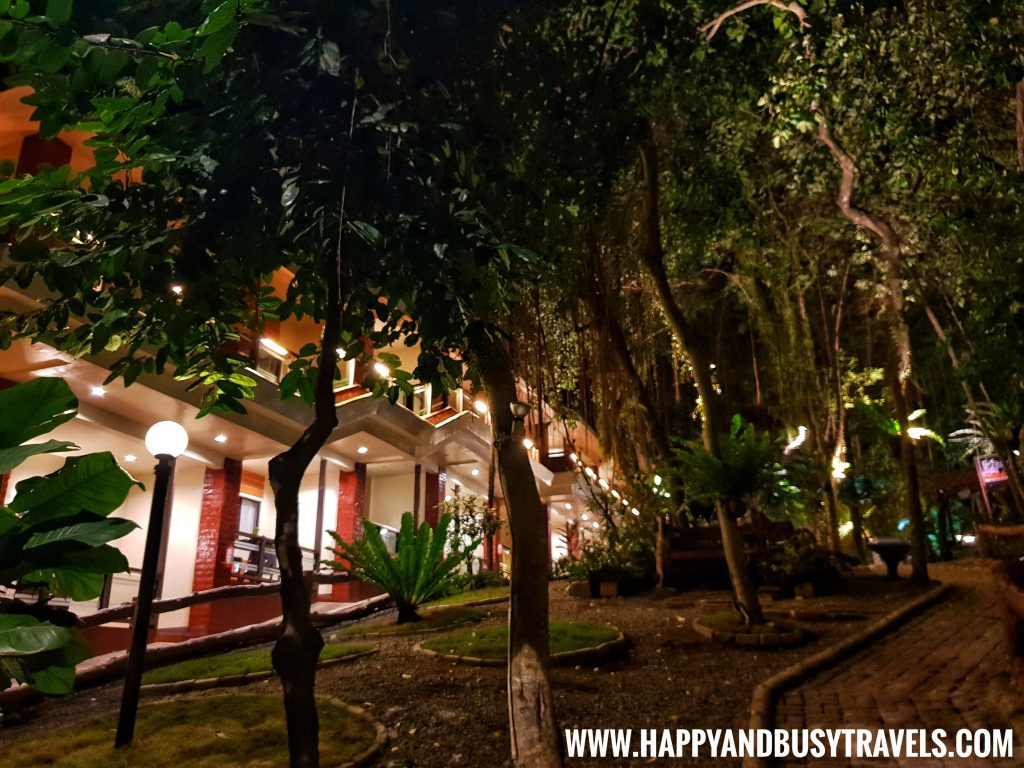 Alona Tropical Beach Resort garden at night