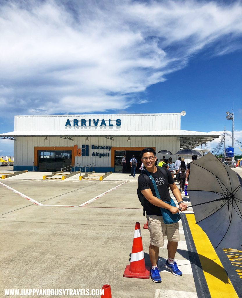 Umbrellas provided upon arrival in Boracay Airport The New Caticlan Airport article of Happy and Busy Travels