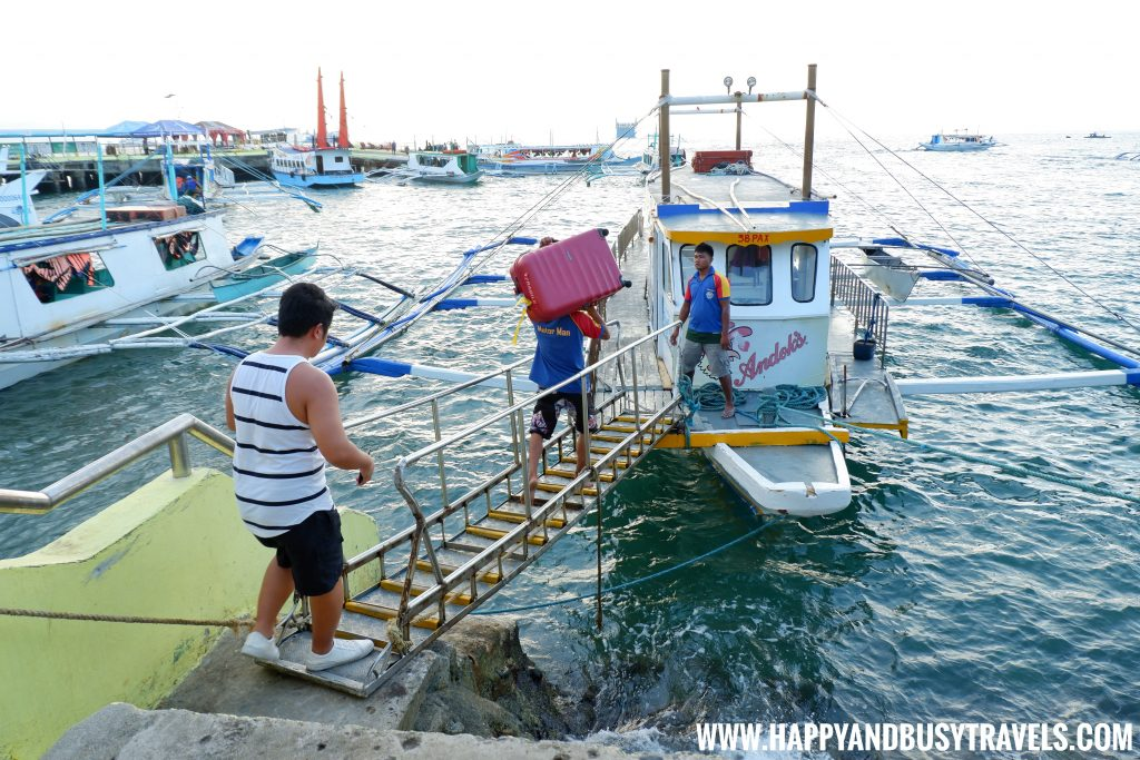 Our baggage being carried in the boat at the Caticlan Jetty Port Boracay Airport the new Caticlan Airport