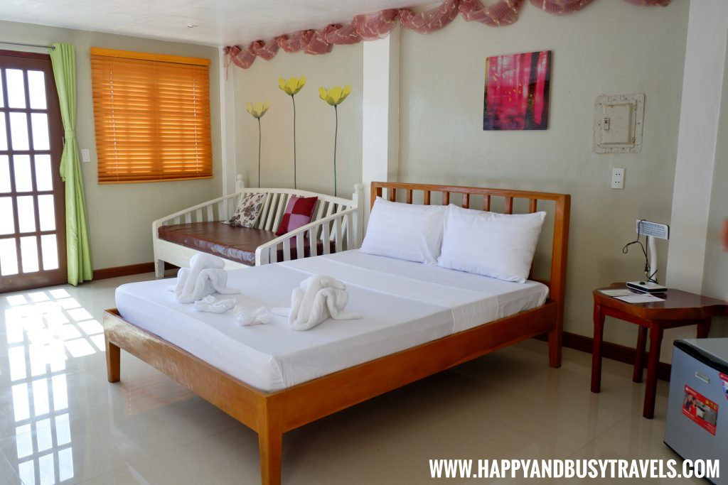 Double bed at the ground floor lighthouse suite of Lanas Beach Resort Happy and Busy Travels to Carabao Island Romblon