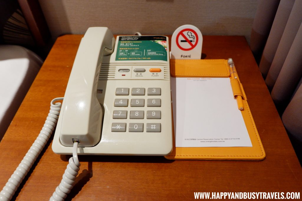 Telephone of the deluxe room of Orange Hotel Kaifong Happy and Busy Travels to Taiwan