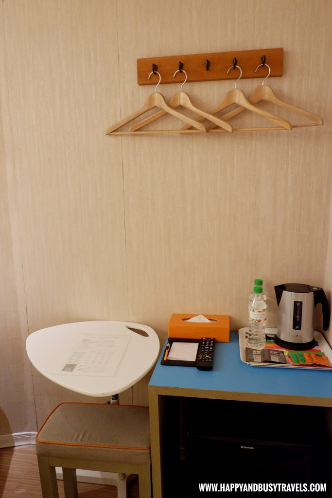 Table and chair Orange Hotel Ximen review of Happy and Busy Travels to Taiwan