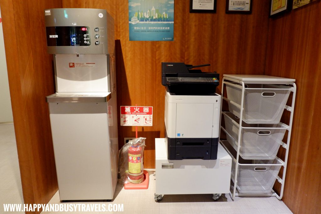 Water and photocopier in the lobby of Orange Hotel Ximen review of Happy and Busy Travels to Taiwan