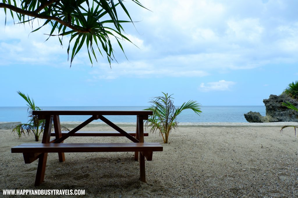 Bench on the beach of Ocean's Edge Resort Carabao Island Romblon Review Happy and Busy Travels