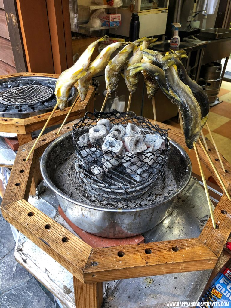 grilling fish in Fuji Q Highland Amusement Park Tokyo Japan review and experience of Happy and Busy Travels