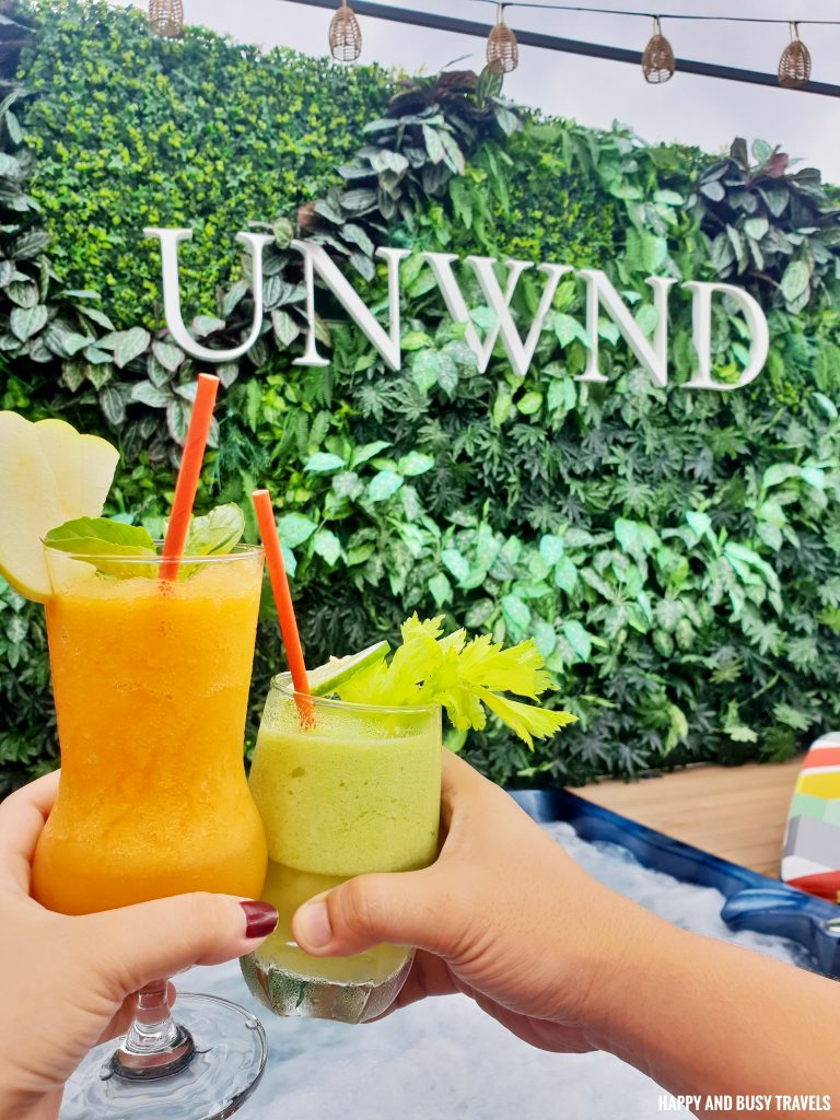 orange booster and green blender shake Unwnd Lux Hostel Poblacion Makati - Happy and Busy Travels review